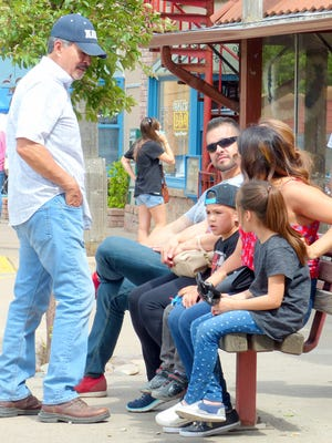 Tourist take a break from shopping and eating in midtown Ruidoso.