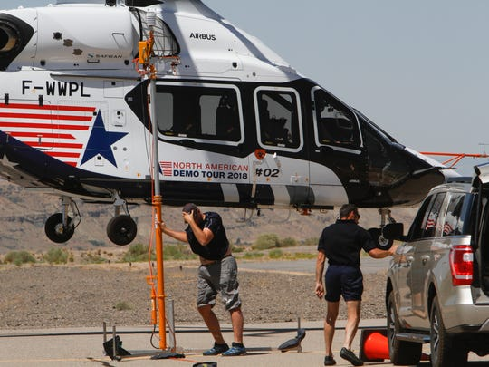 Airbus Helicopters crew members hold down equipment