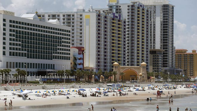 Beachgoers take to the sands this summer in front of the Hilton Daytona Beach Oceanfront Resort in Daytona Beach. Occupancy at Volusia County hotels in June declined by 32% compared with the same month a year ago. Although still a significant downturn, business has rebounded more than initially expected after the coronavirus pandemic hit the tourism industry this spring, hoteliers said.