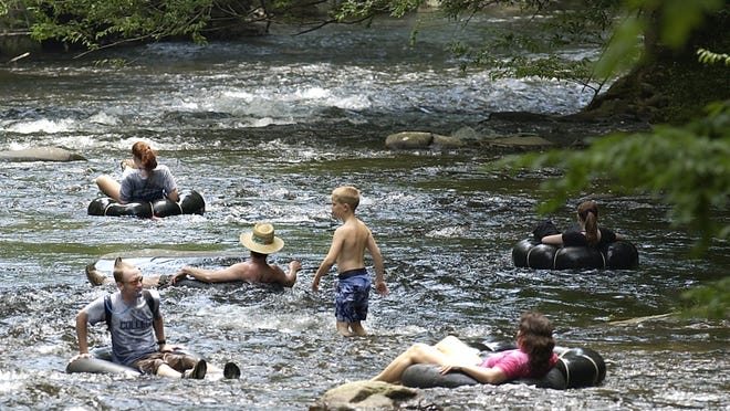 People cool off in Deep Creek in this file photo in the Great Smoky Mountains National Park near Bryson City.