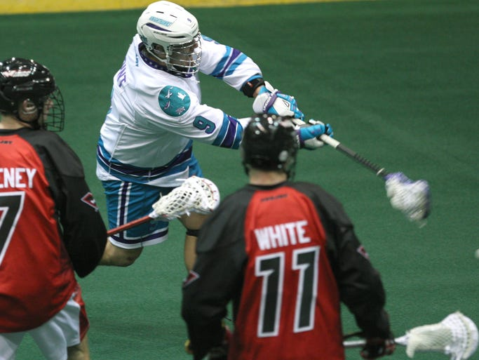 The Knighthawks' Craig Point shoots and scores for a 6-3 lead.