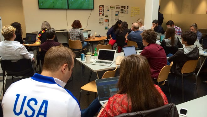 Members of Google's World Cup War Room, tasked with teasing out trending searches throughout the tournament, watch the USA vs. Germany game Thursday at their offices.
