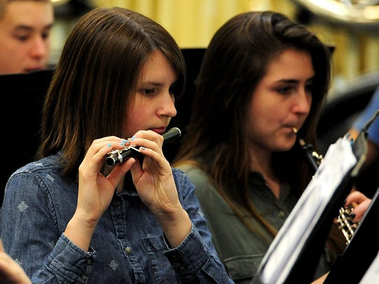 Alyssa Elms plays the piccolo during wind ensemble rehearsal at West Salem High School. The ensemble will defend its title at the OSAA Band State Championships.