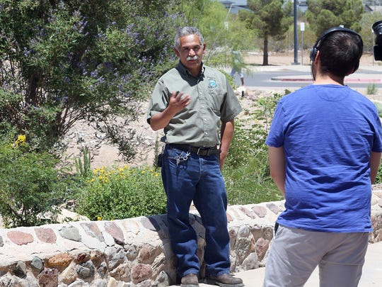 Raul Lucero, grounds district foreman for the El Paso Community College is interviewed by a video crew for the El Paso Chihuahuas about the college's water saving efforts Monday at the Trans Mountain campus.