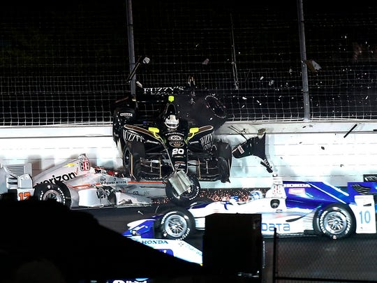 Ed Carpenter lands on top of the car driven by Will