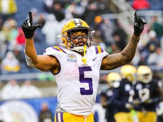 LSU Tigers running back Derrius Guice (5) celebrates after scoring a touchdown against the Notre Dame Fighting Irish in the 2018 Citrus Bowl at Camping World Stadium.