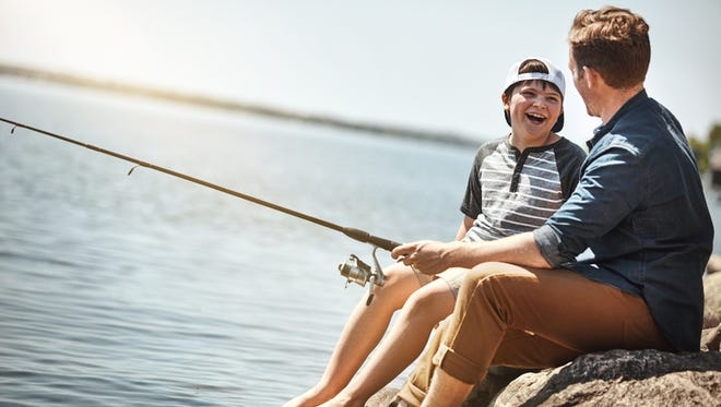 Shot of a father and his little son fishing together