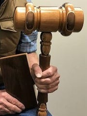 Chester Schulte presented this elaborate, oversized gavel to Iowa Congressman Dave Loebsack, crafted and inlaid with cherry, walnut, poplar and oak. He hopes it someday may call the U.S. House of Representatives to order in Washington, D.C.
