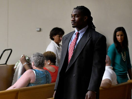 A.J. Johnson enters the courtroom for the second day