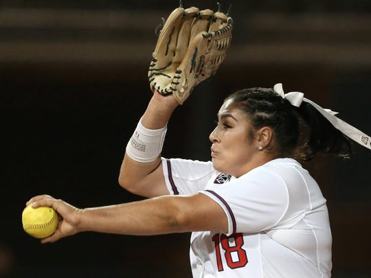 Arizona starting pitcher Taylor McQuillin (18) deals
