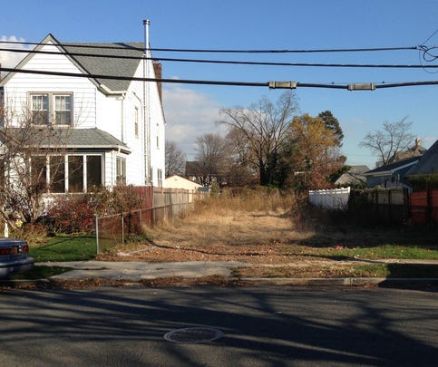 A lot stands empty in West Hempstead, N.Y., on Nov. 25 after the township had the home that once stood on it torn down.