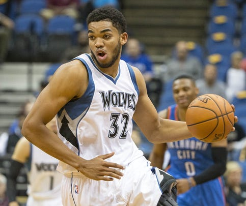 Oct 7, 2015; Minneapolis, MN, USA; Minnesota Timberwolves center Karl-Anthony Towns (32) dribbles the ball after making a steal in the second half against the Oklahoma City Thunder at Target Center. Oklahoma City Thunder won 122-99.