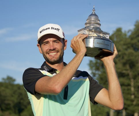 Aug 2, 2015; Gainesville, VA, USA; Troy Merritt holds the Quicken Loans National trophy on the 18th hole after winning in the final round of the Quicken Loans National golf tournament at Robert Trent Jones Golf Club. Mandatory Credit: Rafael Suanes-USA TODAY Sports