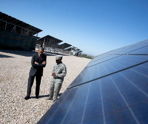 President Obama, accompanied by Col. Ronald E. Jolly, commander of the 75th Air Base Wing at Hill Air Force Base, Utah, tours a solar array at the base in April before speaking about Solar Ready Vets program. A group of such programs is expanding to offer opportunities to transitioning troops, veterans and military spouses.