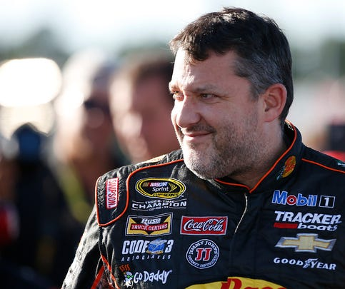 Sep 11, 2015; Richmond, VA, USA; Sprint Cup Series driver Tony Stewart (14) looks on prior to qualifying for the Federated Auto Parts 400 at Richmond International Raceway. Mandatory Credit: Amber Searls-USA TODAY Sports