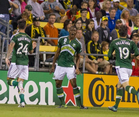 Sep 26, 2015; Columbus, OH, USA; Portland Timbers forward Fanendo Adi (9) celebrates his goal with teammates in the first half of the game against the Columbus Crew SC at MAPFRE Stadium. Mandatory Credit: Trevor Ruszkowski-USA TODAY Sports