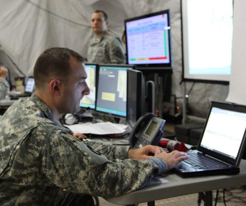First Lt. Samuel Boulet, a battle captain in the 149th Maneuver Enhancement Brigade main tactical operations center, monitors reports and email during a 72-hour command post exercise from June 21-23 at Camp Atterbury, Ind.