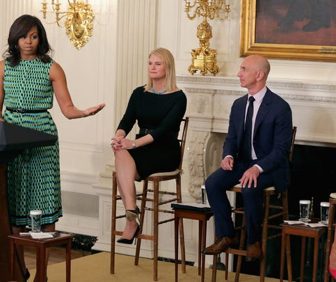 First lady Michelle Obama speaks in the State Dining Room of the White House to announce commitments from companies that have pledged to hire and train veterans and military spouses.