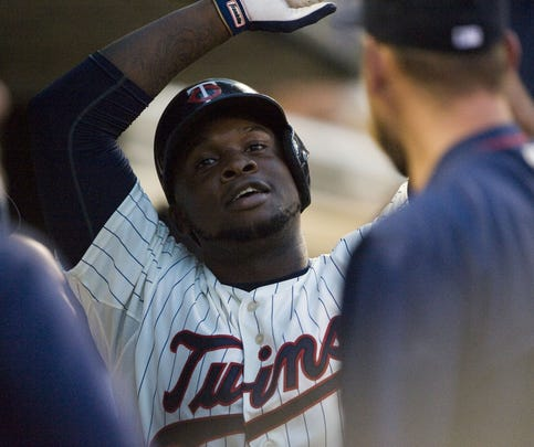 Sep 2, 2015; Minneapolis, MN, USA; Minnesota Twins designated hitter Miguel Sano (22) celebrates his solo home run during the second inning against the Chicago White Sox at Target Field.