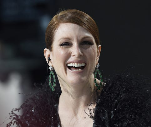 US actress Julianne Moore laughs as she takes part in the Grand Journal tv show, on the sidelines of the 68th Cannes Film Festival in Cannes, southeastern France, on May 13, 2015.