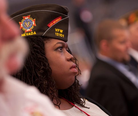 Retired Army Sgt. Vita Lopez, 39, of Nevada listens to President Obama speak at the 116th National Convention of the Veterans of Foreign Wars on July 21 in Pittsburgh. Women veterans have said that they are assumed to be spouses or daughters of male service members when they attend events.