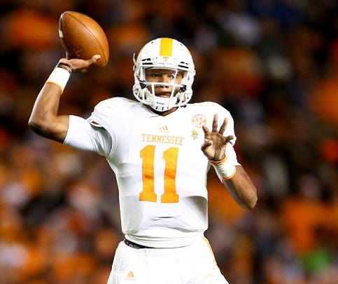 Joshua Dobbs of the Tennessee Volunteers drops back to pass against the South Carolina Gamecocks during their game at Williams-Brice Stadium on November 1, 2014 in Columbia, South Carolina.