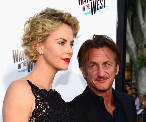 "WESTWOOD, CA - MAY 15:  Actress Charlize Theron and actor Sean Penn arrives at the Premiere Of Universal Pictures And MRC's ""A Million Ways To Die In The West"" at Regency Village Theatre on May 15, 2014 in Westwood, California.  (Photo by Frazer Harrison/Getty Images)"
