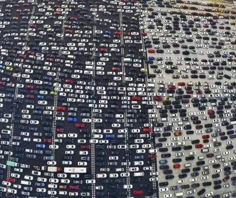 Vehicles are seen stuck in a traffic jam near a toll station as people return home at the end of a week-long national day holiday, in Beijing, Oct. 6, 2015.