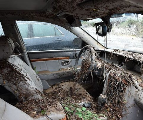The interior of a flooded car is seen in Columbia, South Carolina on October 5, 2015. Record rainfall left large areas of the US southeast under water Sunday as roads were closed and residents were warned to stay indoors. The states of North and South Carolina have been particularly hard hit by heavy flooding, but the driving rain in recent days has spared almost none of the US East Coast. More than 200 swift-water rescues have been reported in South Carolina since late October 3, while the state's Department of Transportation said at least 211 state roads and 43 bridges were closed due to flooding.
