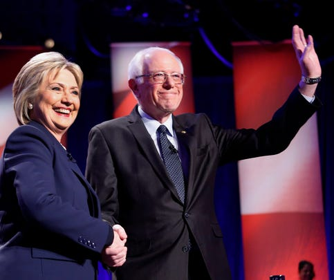 Democratic presidential candidates Hillary Clinton and Sen. Bernie Sanders, I-Vt, pose for a photo before debating at the University of New Hampshire Thursday in Durham, N.H.