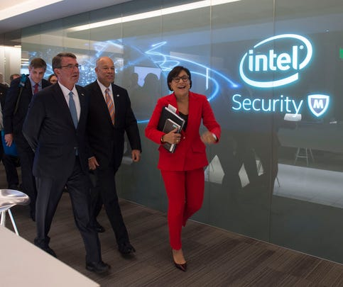 Secretary of Defense Ash Carter walks with Secretary of Homeland Security Jeh Johnson (center) and Secretary of Commerce is Penny Pritzker (right) as they make their way to a press conference during the National Security Telecommunications Advisory Committee meeting held at the Intel Corporation in Santa Clara, Calif., May 11, 2016.