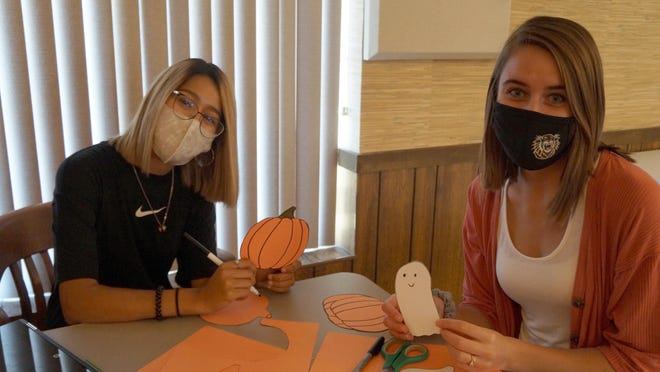 Vanessa Renteria and Joni Enns make October-themed decorations for the new Remote Learning Center at First Presbyterian Church. Renteria, Goodland freshman, is majoring in Early Childhood. Enns, Santanta senior, is majoring in Ag Education.  Both are students at Fort Hays State University.