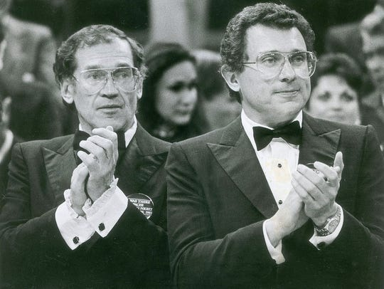 Mel Simon, left, and Herb Simon cheer during the 1983