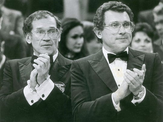 Mel Simon, left, and Herb Simon cheer during the 1983 home opener for the Indiana Pacers at Market Square Arena.