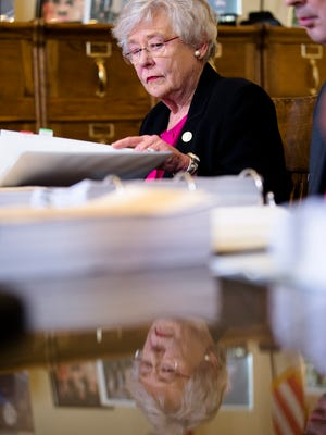 Governor Kay Ivey looks at the election results before certifying the 2017 Special Election for the Senate on Thursday, Dec. 28, 2017, at the Alabama Capitol Building in Montgomery, Ala.