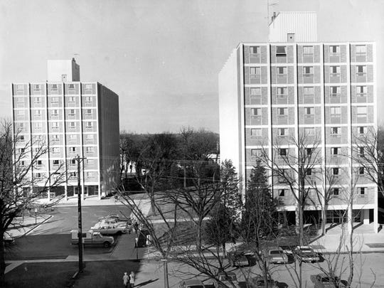 Holes Hall and Stearns Hall at St. Cloud State University are shown. Opened in 1965 as a dormitory, Holes Hall was named after St. Cloud State resident director W.W. Holes.