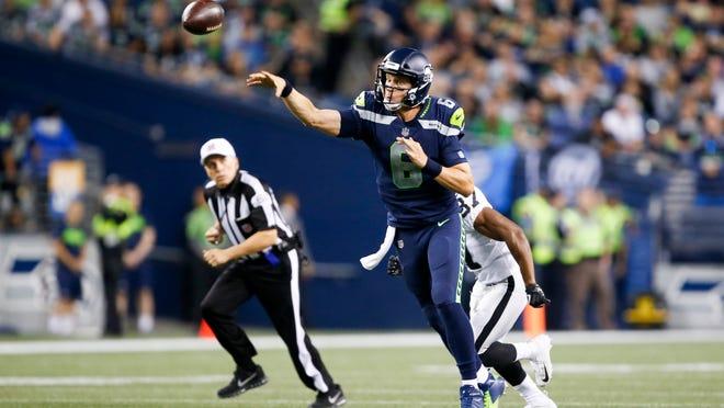 Aug 30, 2018; Seattle, WA, USA; Seattle Seahawks quarterback Austin Davis (6) passes against the Oakland Raiders during the second quarter at CenturyLink Field. Mandatory Credit: Joe Nicholson-USA TODAY Sports