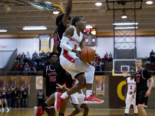 Bosse's Mekhi Lairy (2) drives and shoots against Harrison's