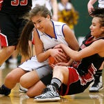 Lewistown's Lexie Anderson, left, and Olivia Hall of Browning fight for control of the ball Friday during the Central A Divisional girls' basketball tournament in the CMR Fieldhouse.