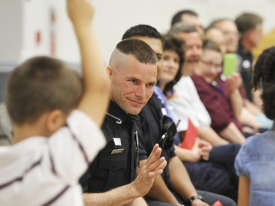 Michael Storeman, a Southern Regional police officer, is pictured in this 2013 file photo at Friendship Elementary School. Police say Storeman is recovering after being injured on the job Wednesday night in Glen Rock.
