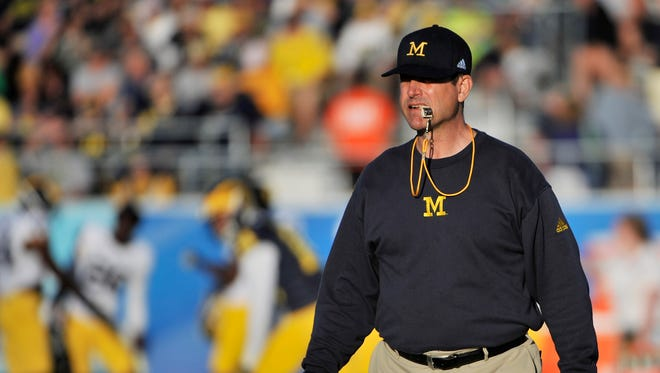Jim Harbaugh runs the practice open to the public in Bradenton on March 4.