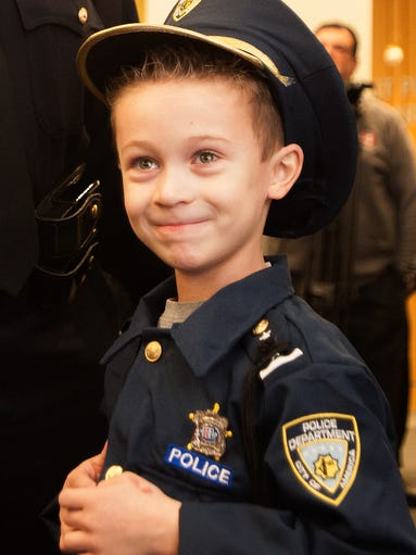 """Detroit """"Chief for a Day"""" Carter Widmer, 7, enjoys"""