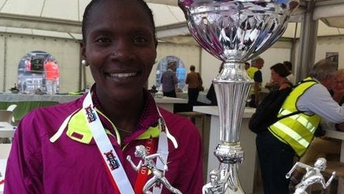 Betsy Saina with her trophy at Tilburg, the Netherlands.
