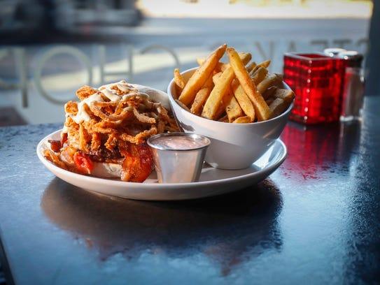 Burger Americana and fries at Americana restaurant