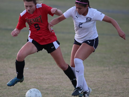 La Quinta's Alexis Garcia and Hemet's Katelyn Nordal battle for the ball on Thursday, February 18, 2016 in La Quinta.