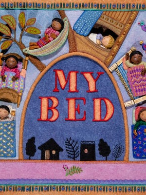 """The front cover of Salley Mavor's book """"My Bed: Enchanting Ways to Fall Asleep Around the World,"""" which is part of an exhibit of her work at Cahoon Museum of American Art in Cotuit."""