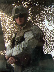 Marine Cpl. Donald Fowler, a Purple Heart recipient who was deployed to Iraq three times, poses for a photograph. Fowler was killed in a high desert car crash on Feb. 7, 2011.
