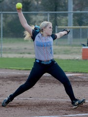South Gibson's Madelyn Mosier winds back for a pitch during Thursday's game against South Side.