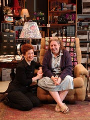"""Actors Lisa Kron, left, and Jayne Houdyshell smile during a photo session on the set of Kron's play """"Well"""" at the Public Theater in New York March 26, 2004. Houdyshell portrays Kron's mother in the comedy, which runs through May 16."""