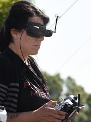 "Pilot ""Little A"" from Mexico of Team Platinum Misfits runs her drone as Teams from the International Drone Racing Association held their event at Dover International Speedway on Sunday June 4th before the start of the 48th Annual AAA 400 Drive for Autism Race held at the speedway."